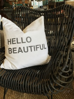"The ""Hello Beautiful"" pillow that has gained popularity from being displayed at Fisher's restaurant."